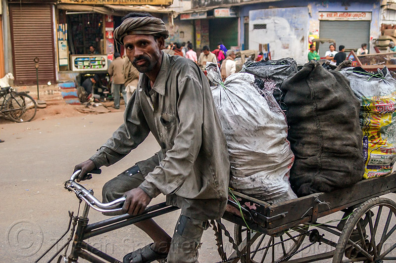 coal man (india), bags, bearer, cargo tricycle, cargo trike, charcoal, coal, coalman, dirty, freight tricycle, freight trike, load, man, moving, pushing, sacks, street, transport, transportation, transporting, varanasi, walking