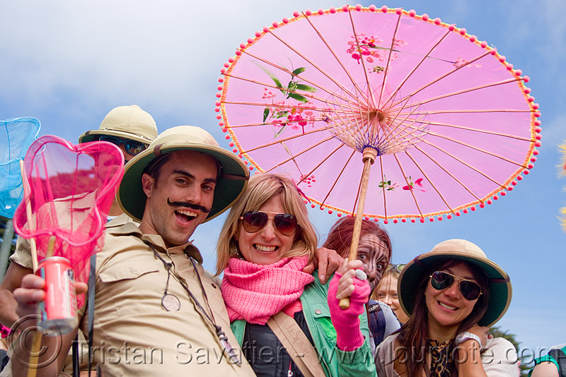 colonial pith helmets and pink japanese umbrella, bay to breakers, colonial pith helmet, costume, footrace, helmets, japanese umbrella, man, pink, street party, woman