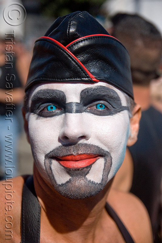 colored contact lenses - very blue eyes, blue contact lenses, blue contacts, chi energy, color contact lenses, dore alley fair, face painting, facepaint, leather hat, makeup, man, red lipstick, special effects contact lenses, theatrical contact lenses, white face paint