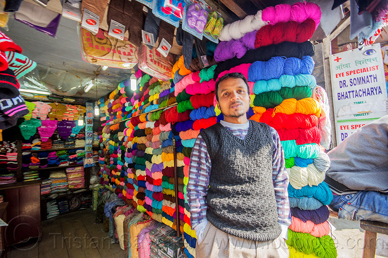 colorful cotton skeins in shop - darjeeling (india), man, merchant, people, rainbow colors, standing, store, vendor, wool