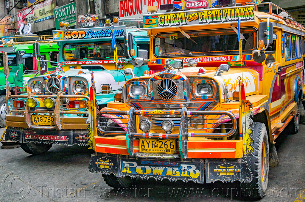 colorful jeepneys parked at jeepney station in baguio (philippines), baguio, colorful, decorated, front grill, jeepney, painted, philippines, road, truck