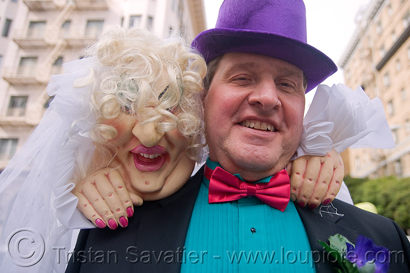 colorful man with his bride - brides of march (san francisco), bow tie, brides of march, couple, dickie bow, festival, green shirt, man, purple hat, wedding, white