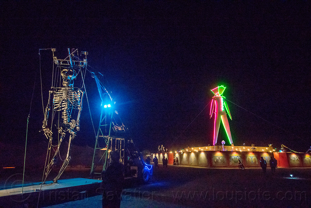 colossal skeleton marionette - burning man 2015, burning man, colossal skeleton marionette, giant puppet, glowing, metal, neon, night, the man