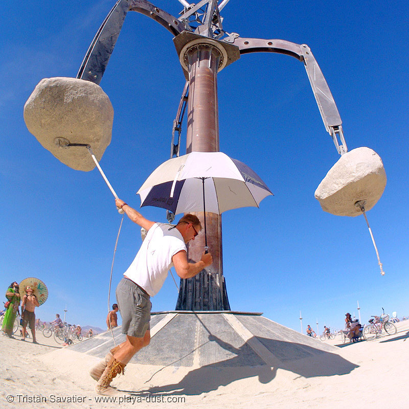 colossus by zachary coffin - burning-man 2005, art, art installation, burning man, mast, people, rope, stones, umbrella