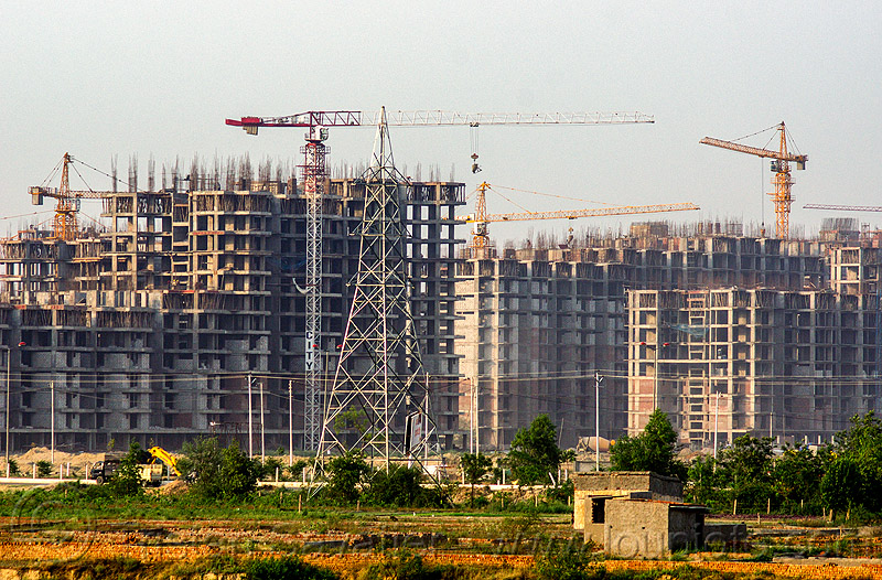 "construction of the planned urban development ""gaur city 1"" in greater noida (india), bamboo scaffoldings, buildings, construction cranes, electricity pylon, planned city, transmission tower, urban planning"
