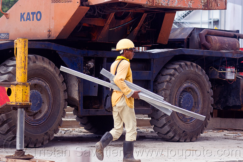 construction worker - KATO mobile crane, building construction, construction site, construction workers, hydraulic cylinder, kato, machinery, man, miri, mobile crane, safety helmet, tires, walking, wheels, working