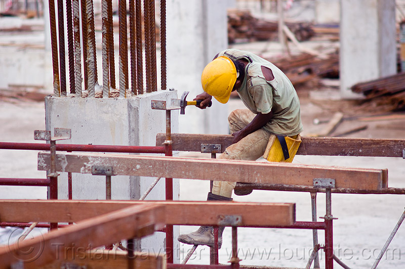 construction worker - shoring, building construction, construction site, construction workers, hammer, lumber, man, miri, rebars, safety helmet, scaffolding, shoring, sitting, timber, working