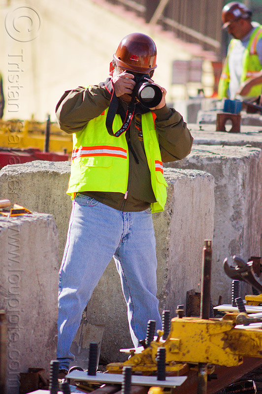 construction worker taking photos, camera, construction worker, duboce, high-visibility jacket, high-visibility vest, light rail, men, muni, ntk, photographer, railroad construction, railroad tracks, rails, railway tracks, reflective jacket, reflective vest, safety helmet, safety vest, san francisco municipal railway, track maintenance, track work, wrench