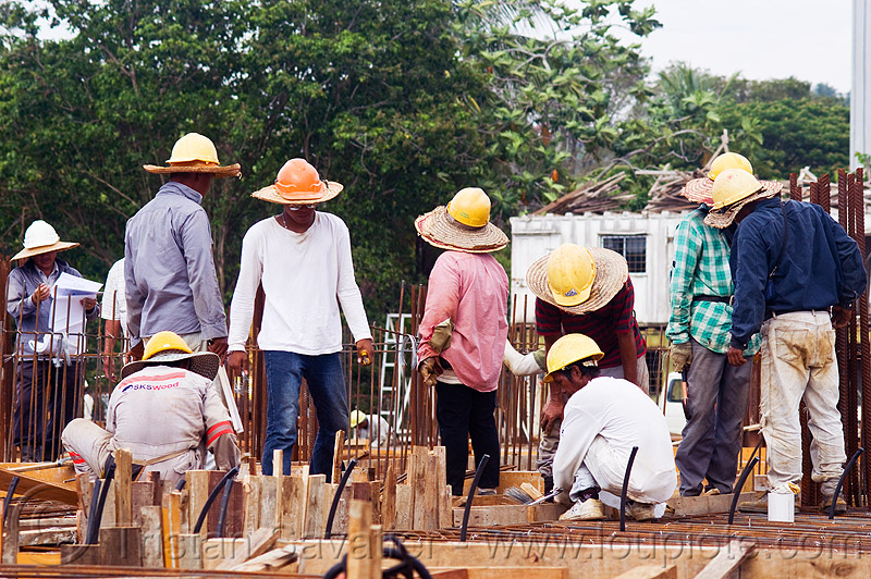 construction workers with straw hats and safety helmets, building construction, concrete forms, concrete wall forms, construction site, construction workers, formwork, lumber, man, miri, rebars, safety helmet, standing, straw hat, sun hat, timber