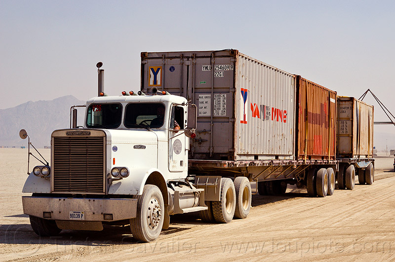 containers on semi truck - burning man 2012, articulated lorry, big rig, burning man, containers, flat bed, semi trailer, semi truck, tractor-trailer, trucks