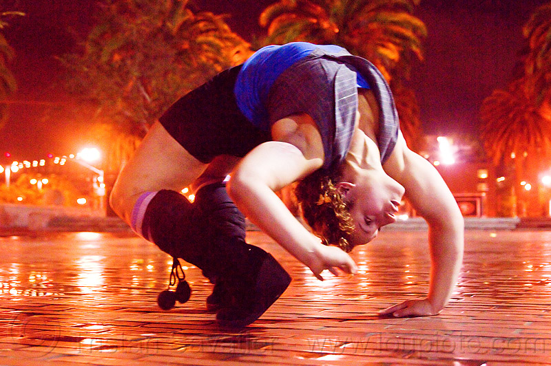 contortionist leaning backward - street artist (san francisco), back stretching, brick floor, brick tiles, contortionist, night, stretch, woman