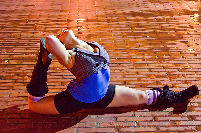 contortionist, back stretching, brick floor, brick tiles, justin herman plaza, night, people, stretch, woman