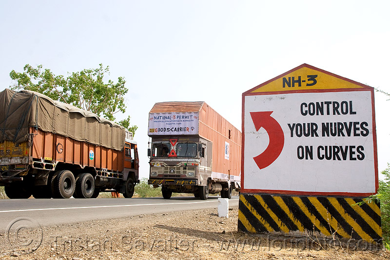 control your nurves on curves (sic!) - road sign (india), curves, highway, lorry, nerves, nh-3, nurves, red arrow, road marker, road sign, traffic sign, trucks, turn