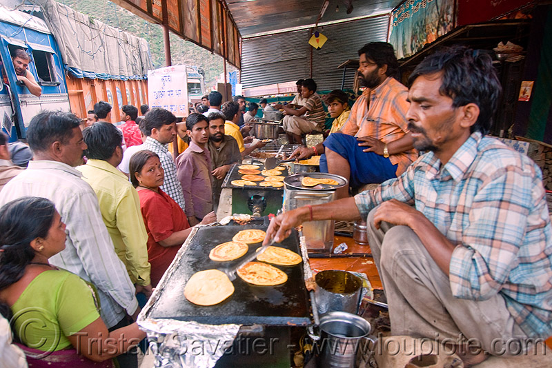 cooking pancakes - langar (free community kitchen) - amarnath yatra (pilgrimage) - kashmir, amarnath yatra, cooking, cooks, crowd, food, hindu pilgrimage, india, kashmir, kitchen, langar, men, pan, pancakes, sikh, sikhism