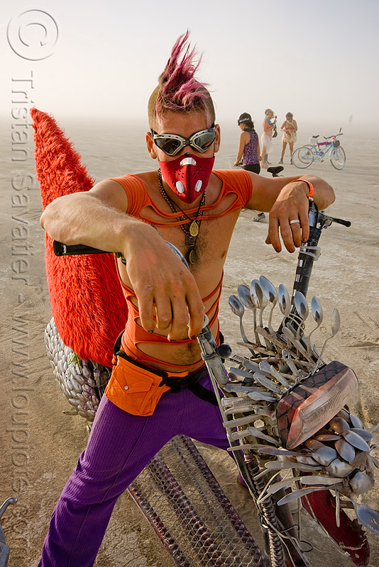 cool burner with mohawk and spoon fish bike - eric - burning man 2009, art car, burning man, dust mask, fish bike, goggles, mohawk hair, motorcycle, mutant vehicles, respirator, rider, riding, spoon bike, spoon scooter, spoons