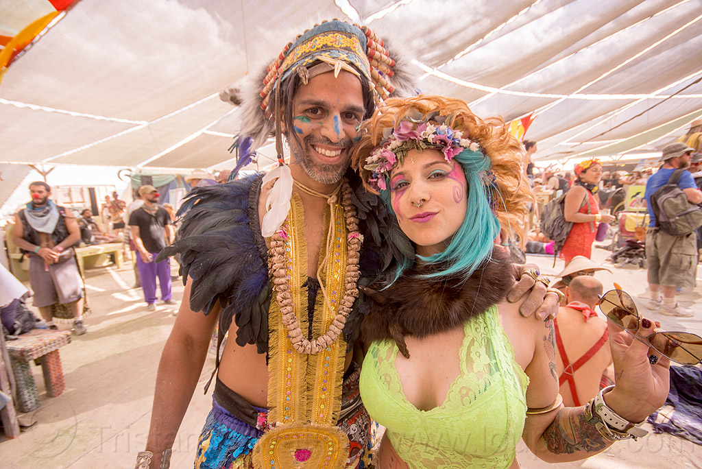 couple - center camp - burning man 2015, burning man, center camp, couple, feathers, headdress, necklace, tribal costume, woman