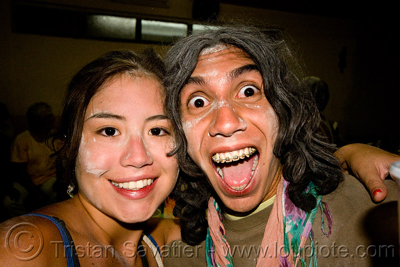 couple enjoying the carnaval de humahuaca (argentina), andean carnival, argentina, asian woman, dental braces, drunk, man, noroeste argentino, orthodontic braces, quebrada de humahuaca, talk powder, teeth