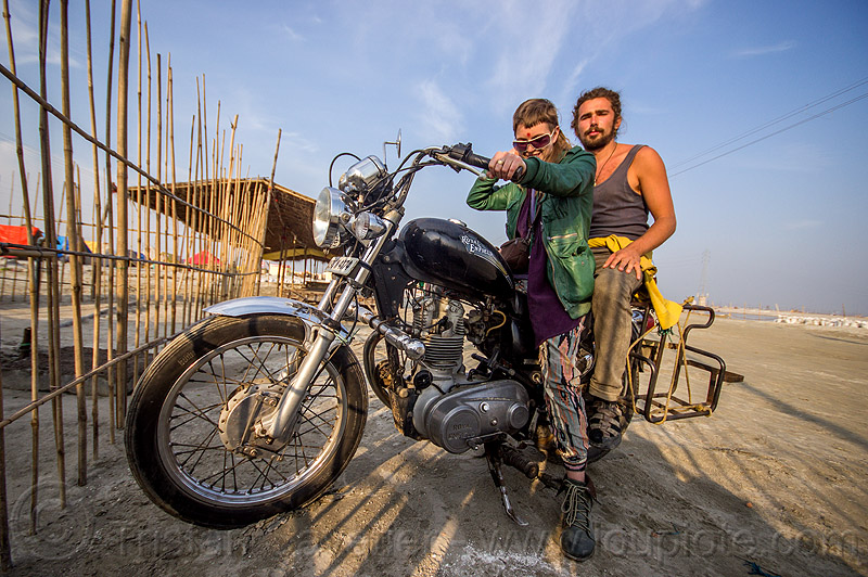 couple riding royal enfield bullet thunderbird motorcycle, 350cc, bun bun, fence, hindu pilgrimage, hinduism, india, maha kumbh mela, man, motorcycle touring, motorcyclists, rider, riding, royal enfield bullet, thunderbird, wojtek, woman