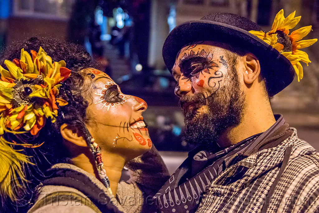 couple with sugar skull makeup - dia de los muertos, beard, couple, day of the dead, dia de los muertos, face painting, facepaint, halloween, hat, man, night, sahar, sugar skull makeup, woman