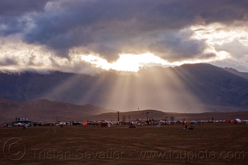 crepuscular rays and stormy sky over burning man 2010, clouds, cloudy, dusk, haze, hazy, people, shadows, sun light, sun rays