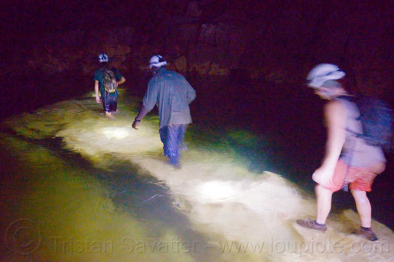 crossing the river on a underwater natural bridge - clearwater cave - mulu (borneo), cavers, caving, clearwater cave system, clearwater connection, clearwater river, fording, gunung mulu national park, natural bridge, natural cave, river cave, river crossing, roland, spelunkers, spelunking, underground river, underwater bridge, wading, water
