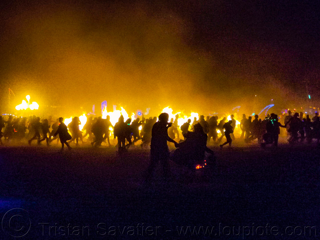 crowd celebrating the man's burn - burning man 2019, burning man, night of the burn