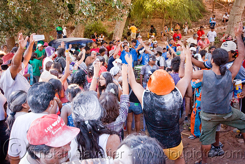 crowd dancing around the apacheta - carnaval de tilcara (argentina), andean carnival, noroeste argentino, people, quebrada de humahuaca