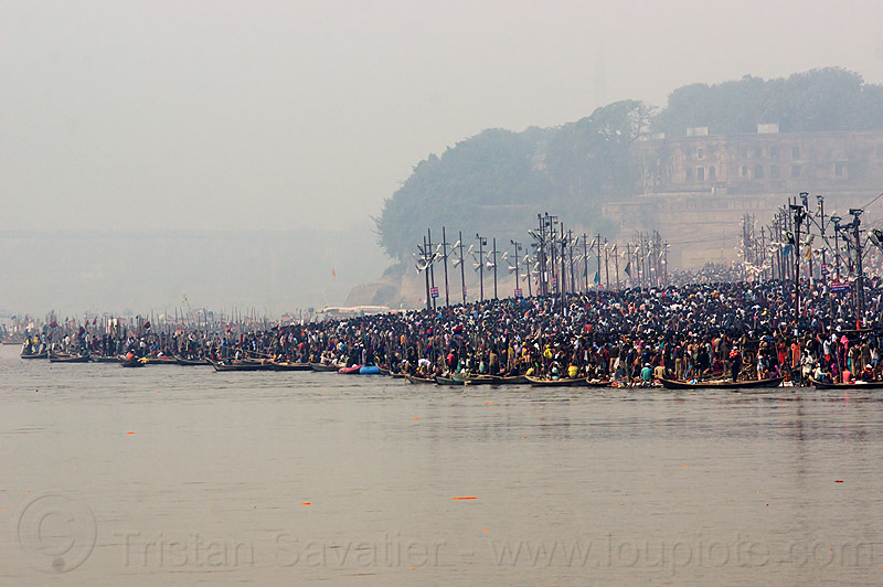 crowd of hindu devotees taking the holy dip in the ganges river at kumbh mela (india), allahabad fort, crowd, ganga, ganges river, hindu pilgrimage, hinduism, holy bath, holy dip, india, maha kumbh mela, nadi bath, pilgrims, river bank, river bathing, triveni sangam
