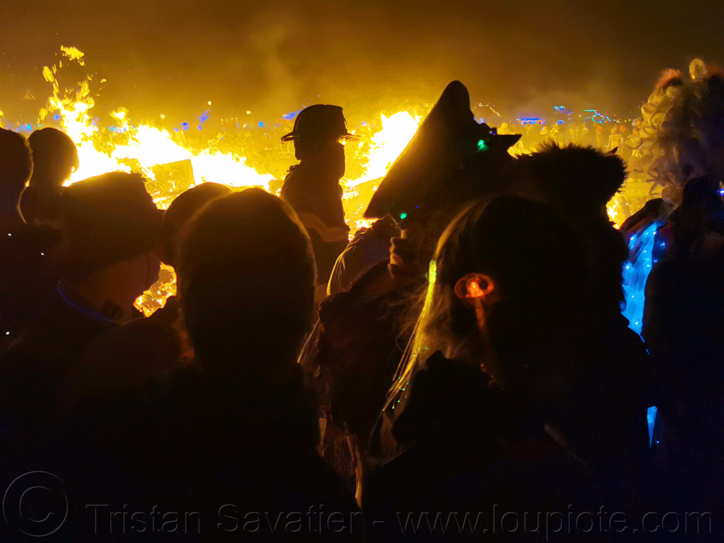 crowd running around the man's burn - burning man 2019, burning man, night of the burn