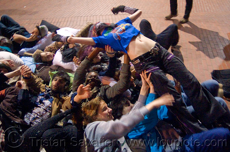 crowd-surfing at the great san francisco pillow fight 2009, crowd surfer, crowd surfing, down feathers, night, pillow fight club, pillows, woman, world pillow fight day