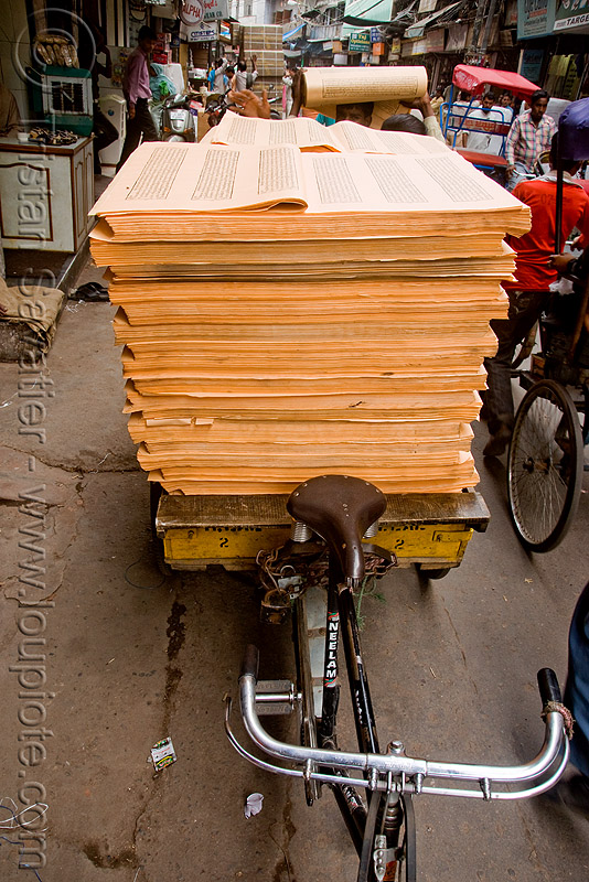 cycle rickshaw loaded with sheets of printed paper (india), delhi, jayyed press, people, print shop, printed sheets, printing shop, tibetan prayers