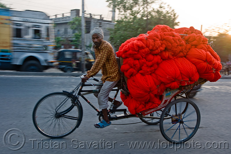 cycle rickshaw with a load of red wool (india), cycle rickshaw, freight, load, man, moving, red, skeins, street, tricycle, wallah, wool