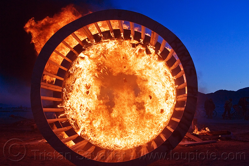 cylindrical wooden frame burning at dusk, burning man, cylinder, fire, flames, wood