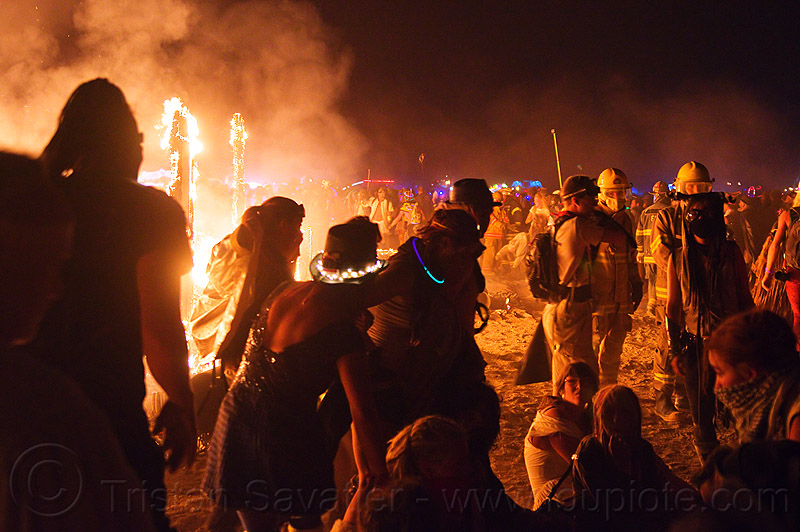 dancing around the fire - burning man 2012, backlight, burning, dancing, drown, fire, firefighters, flames, night, silhouettes, the man