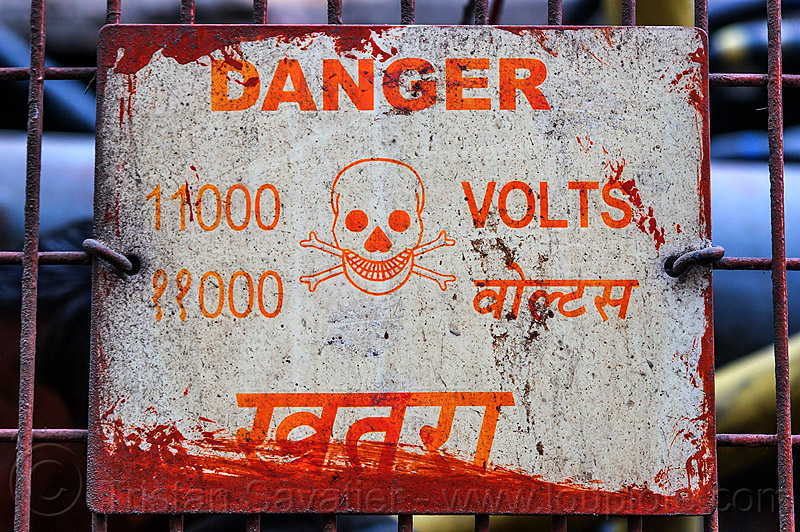 danger 11000 volts sign (india), 11000, crossbones, danger, delhi, electric, electricity, high voltage, india, sign, skull, volts