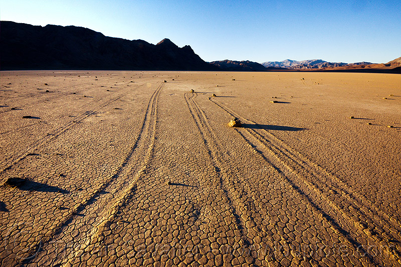 death valley racetrack, cracked mud, death valley, desert, dry lake, dry mud, mountains, moving rocks, racetrack playa, sailing stones, sliding rocks, tracks