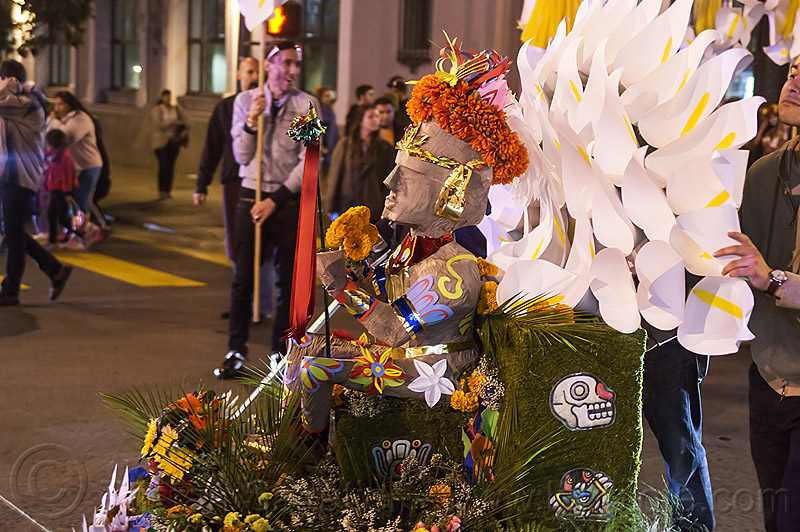 decorated aztec statue - dia de los muertos procession (san francisco), aztec sculpture, calla lilies, day of the dead, flower crown, flowers, halloween, marigold, night, orange flowers, orange marigold