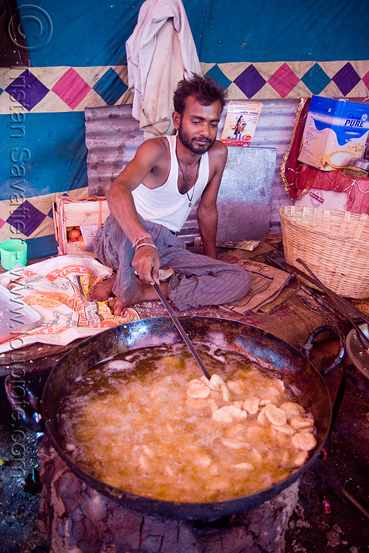deep-frying - langar (free community kitchen) - amarnath yatra (pilgrimage) - kashmir, amarnath yatra, cooking oil, cooks, deep-frying, food, hindu pilgrimage, india, kashmir, kitchen, langar, man, sikh, sikhism, wok