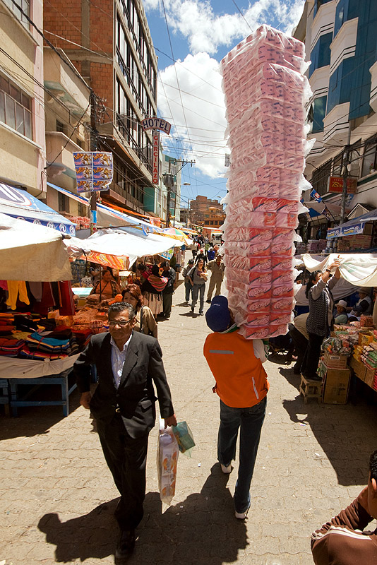 delivery man carrying high stack, bearer, la paz, load, market, men, people, porter, street, wallah