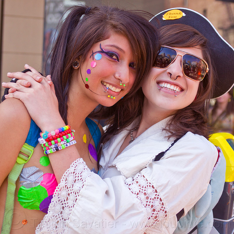 devin and jessica, color pasties, color polka dots, devin, jessica, kandi bracelet, lip piercing, nose piercing, pirate costume, rainbow pasties, rainbow polka dots, septum piercing, women