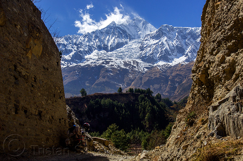 dhaulagiri peak and its glacier (nepal), annapurnas, cliff, cloud, dirt road, forest, house, kali gandaki, kali gandaki valley, motorbike, motorbike touring, motorcycle, motorcycle touring, mountain road, mountains, snow, unpaved