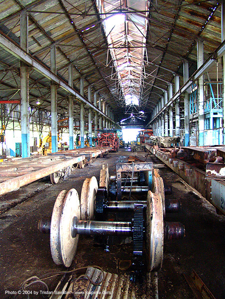 diesel-electric train engine axles - wheels, abandoned, atlantic railway, axle, costa rica, decay, industrial, puerto limon, rusted, rusty, train axles, train depot, train engines parts, train wheels, train yard, trespassing, urban exploration, warehouse
