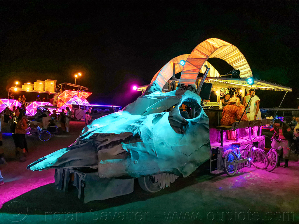 dirty goat roadhouse art car - burning man 2019, bighorn, burning man, dirty goat art car, dirty goat roadhouse art car, glowing, mutant vehicles, night, skull art car