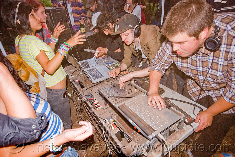 DJs at renegade rave party, audio mixers, deejays, dj equipment, dj mixers, djs, laptops, men, party, raver, sound, turn tables