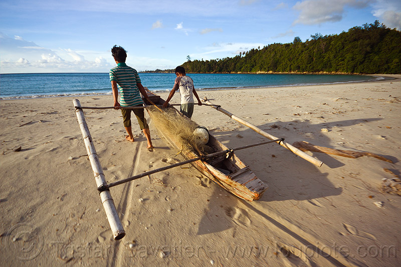 double outrigger fishing canoe on beach, bangka, boy, double outrigger canoe, fisherman, fishermen, fishing canoe, fishing net, kelambu beach, man, ocean, rain forest, sand, sea, seashore, shore, small boat