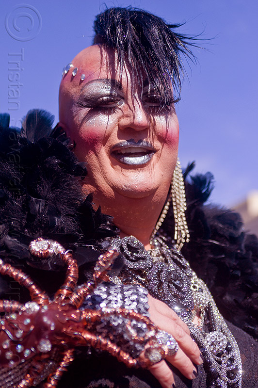 drag queen with black feathers - vivian, bindis, black feathers, drag queen, earrings, folsom street fair, man, mohawk hair, necklace, vivian