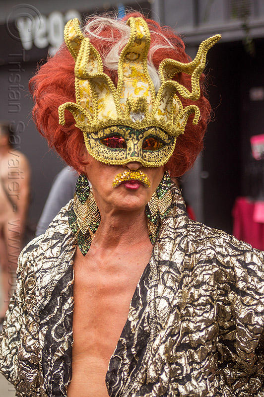 drag queen with golden carnival mask, carnival mask, drag queen, earrings, man, masked, red hair, redhead, wig
