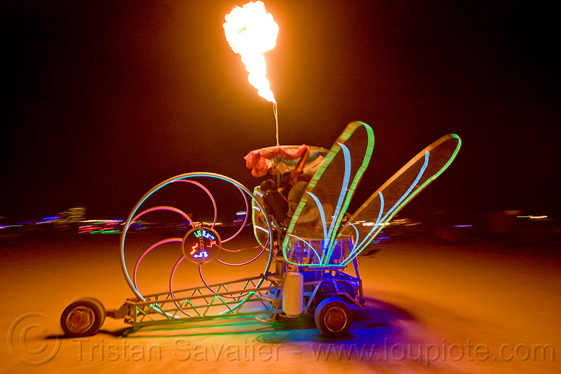 dragonfly art car, art car, burning man, chris merrick, dragonfly, el-wire, fire, glowing, mutant vehicles, night, now-a-saurus