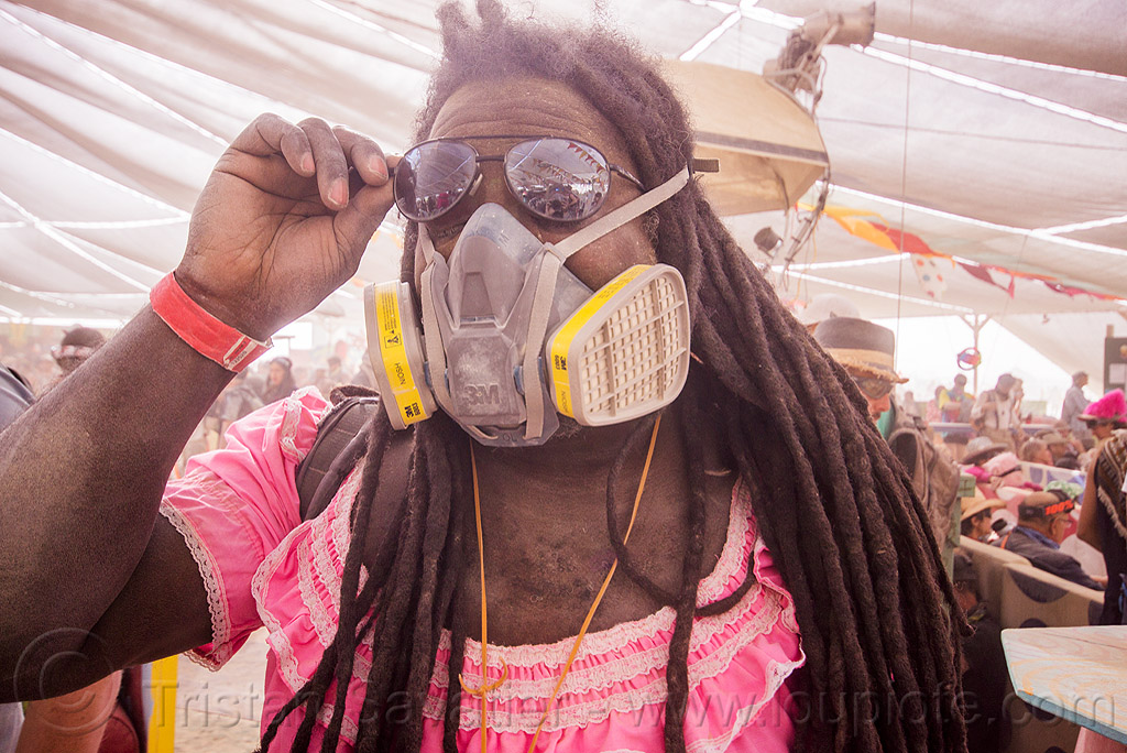 dreadlocks and dust mask - burning man 2015, burning man, center camp, dreadlocks, dreads, dust mask, dust particulate mask, dusty, pink dress, sunglasses