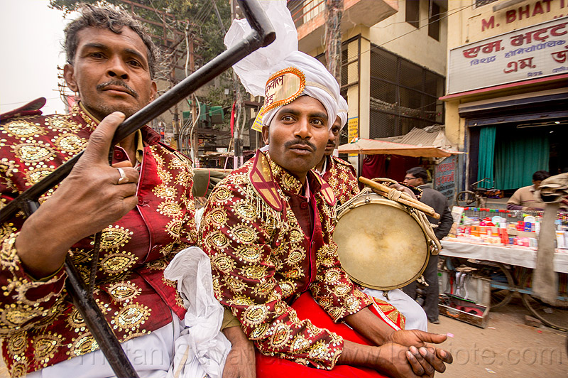dressed-up musicians with drum on their way to a wedding (india), cycle rickshaw, dressed-up, drum, drummer, headdress, india, indian wedding, men, music band, musicians, turban, uniform, varanasi